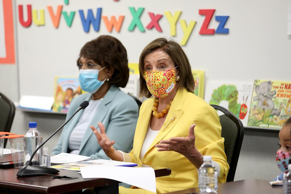 LOS ANGELES, CA - AUGUST 12: House Speaker Nancy Pelosi, right, D-San Francisco, shown with Rep. Maxine Waters, D-Los Angeles, hold a news conference to discuss the importance of the Child Tax Credit at the Ethel Bradley Early Education Center Thursday, Aug. 12, 2021 in Los Angeles, CA. (Gary Coronado / Los Angeles Times via Getty Images)