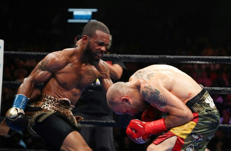Gary Russell Jr. punches Kiko Martinez on the way to victory in their WBC featherweight world title fight
