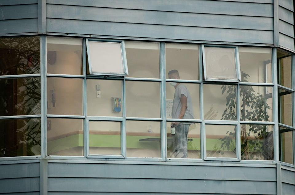 """<span class=""""caption"""">A worker is seen cleaning surfaces inside Little Mountain Place, a not-for-profit long-term care home in Vancouver where dozens of residents have died in the COVID-19 pandemic. </span> <span class=""""attribution""""><span class=""""source"""">THE CANADIAN PRESS/Darryl Dyck </span></span>"""