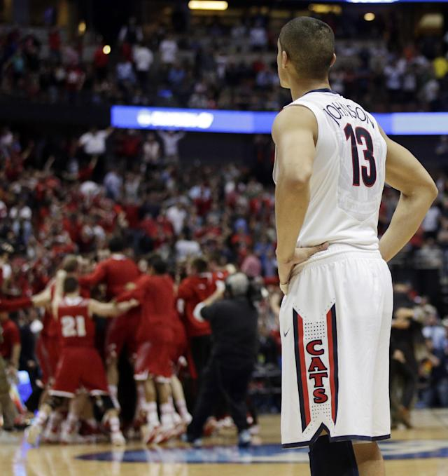 Arizona's Nick Johnson watches as Wisconsin celebrates after overtime in a regional final NCAA college basketball tournament game, Saturday, March 29, 2014, in Anaheim, Calif. Wisconsin won 64-63 in overtime. (AP Photo/Jae C. Hong)