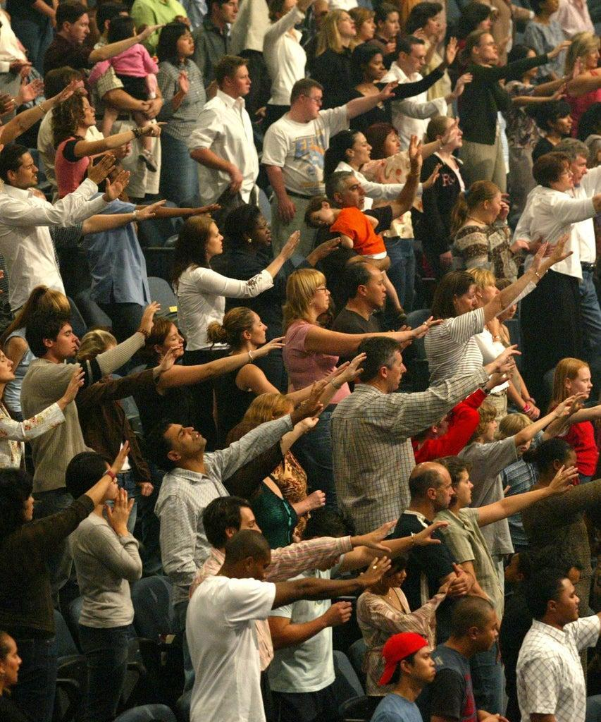 (AUSTRALIA OUT) Devoted Christians celebrating Easter Sunday at the Hillsong Church at Baulkham Hills in Sydney, 11 April 2004. SMH Picture by BEN RUSHTON (Photo by Fairfax Media via Getty Images/Fairfax Media via Getty Images via Getty Images)