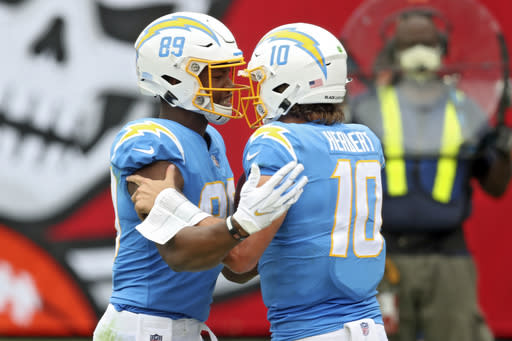 Los Angeles Chargers tight end Donald Parham Jr., (89) celebrates with quarterback Justin Herbert (10) after Parham Jr., caught a 19-yard touchdown pass during the first half of an NFL football game against the Tampa Bay Buccaneers Sunday, Oct. 4, 2020, in Tampa, Fla. (AP Photo/Mark LoMoglio)
