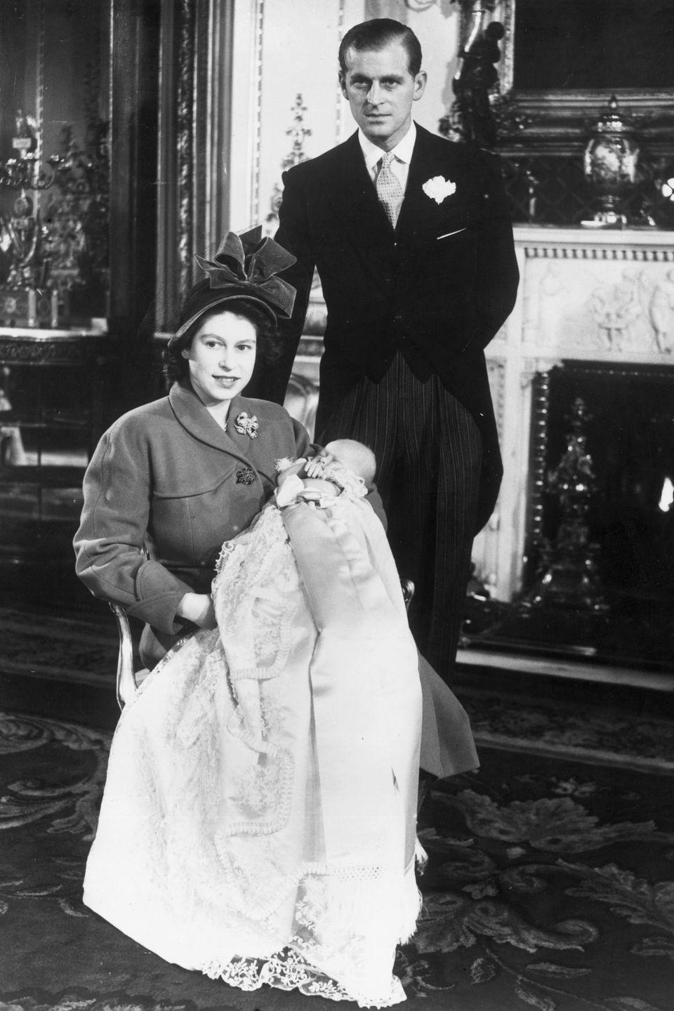 <p>An adorable family portrait of Princess Elizabeth and Prince Philip with their son Prince Charles.</p>