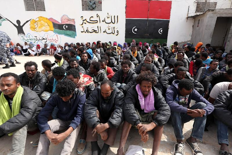 Migrants who were hoping to reach Europe by boat sit at Abu Salim detention centre for illegal migrants in Tripoli, Libya on April 21, 2015 (AFP Photo/Mahmud Turkia)