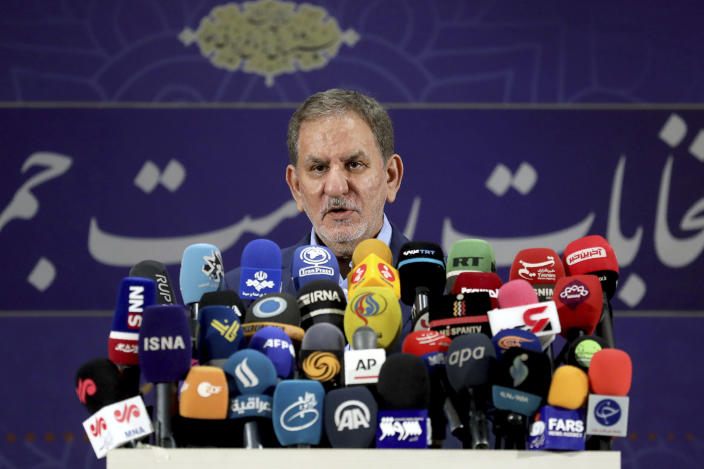 Iranian Vice-President Eshaq Jahangiri speaks to media after registering his name as a candidate for the June 18 presidential elections at the elections headquarters of the Interior Ministry in Tehran, Iran, Saturday, May 15, 2021. (AP Photo/Ebrahim Noroozi)
