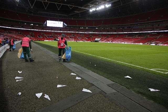 Bored fans threw paper aeroplanes onto the pitch throughout a tedious qualification-sealing win against Slovenia that offered little hope England can improve on their wretched major tournament record, at Wembley Stadium in London, on October 5, 2017 (AFP Photo/ADRIAN DENNIS)