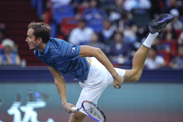 Daniil Medvedev of Russia serves against Stefanos Tsitsipas of Greece during their men's singles semifinals match at the Shanghai Masters tennis tournament at Qizhong Forest Sports City Tennis Center in Shanghai, China, Saturday, Oct. 12, 2019. (AP Photo/Andy Wong)