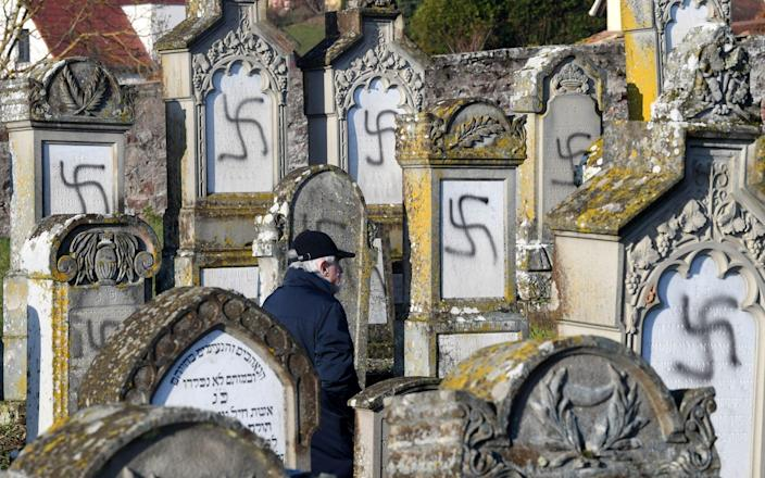 Anti-Semitism is a crime, said President Emmanuel Macron, after 107 Jewish graves were desecrated in Alsace, eastern France - Maxppp