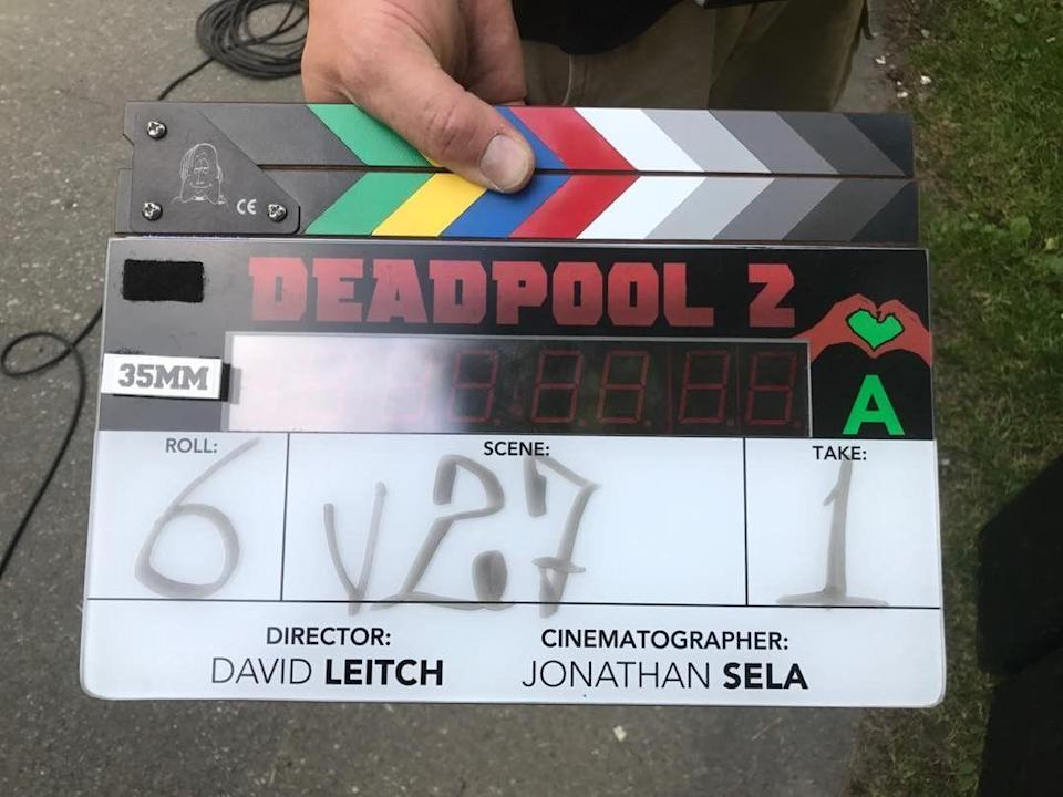"""<p>Director David Leitch posted this pic of his clapboard to mark the official start of filming on June 26, 2017. Reynolds posted similar image later on with the caption: """"The sun sets on day 1. Feels good to be back. This dog can hunt."""" (Photo: <a href=""""https://www.instagram.com/p/BV1F1MbHS3J/"""" rel=""""nofollow noopener"""" target=""""_blank"""" data-ylk=""""slk:davidmleitch/Instagram)"""" class=""""link rapid-noclick-resp"""">davidmleitch/Instagram)</a> </p>"""