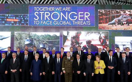 EU leaders take part in a group photo on the launching of the Permanent Structured Cooperation, or PESCO, a pact between 25 EU governments to fund, develop and deploy armed forces together, during a EU summit in Brussels, Belgium, December 14, 2017. REUTERS/Yves Herman