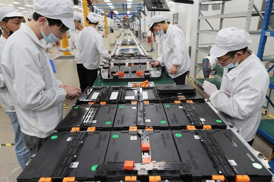 Workers at Xinwangda Electric Vehicle Battery Co.'s factory in the Jiangsu provincial capital of Nanjing, on March 12, 2021. Photo: AFP.
