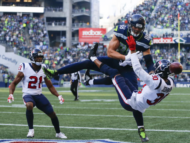 <p>Tight end Jimmy Graham #88 of the Seattle Seahawks can't bring in an end zone pass against cornerback Kevin Johnson #30 of the Houston Texans during the third quarter of the game at CenturyLink Field on October 29, 2017 in Seattle, Washington. (Photo by Jonathan Ferrey/Getty Images) </p>