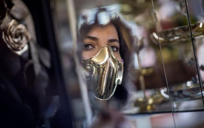 A model tries Golden protective face mask design of silver master Sabri Demirci for Coronavirus at his silver shop in Istanbul, Turkey - Erdem Sahin/EPA-EFE/Shutterstock