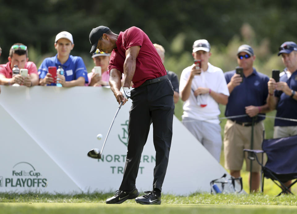 Tiger Woods hits a tee shot on the fifth hole during the final round of the Northern Trust golf tournament, Sunday, Aug. 26, 2018, in Paramus, N.J. (AP Photo/Mel Evans)