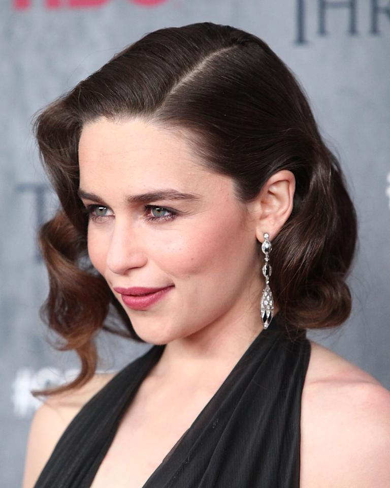 <p>For the <strong>Game of Thrones </strong>season four premiere, Clarke channeled Old Hollywood glamour with some retro barrel curls. Her 1920s hairdo was styled with a deep side part and slicked back behind her ear on one side for extra drama.</p>