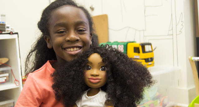 Young girls of color get excited about Healthy Roots Dolls, which look like them. (Photo: Courtesy of Yelitsa Jean-Charles)