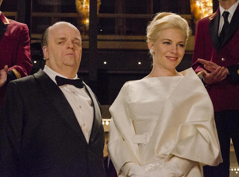 """This image released by HBO shows Toby Jones, portraying Alfred Hitchcock, left, with Sienna Miller, portraying Tippi Hedren, in a scene from the film """"The Girl,"""" premiering Saturday, Oct. 20, 2012 at 9 p.m. EST. The HBO movie dramatizes the making of Hitchcock's """"The Birds"""" and his relationship with Hedren. (AP Photo/HBO, Kelly Walsh)"""