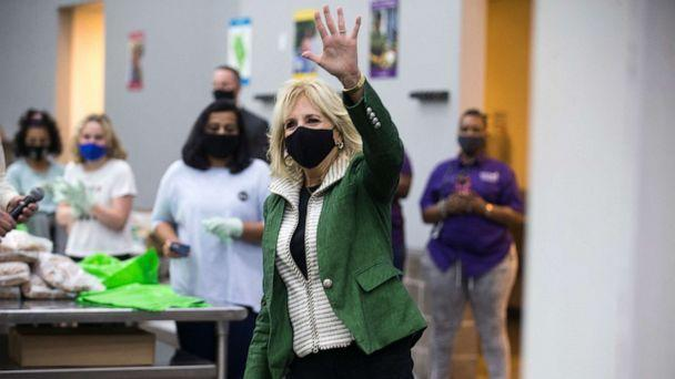 PHOTO: First Lady Jill Biden waves at volunteers as she arrives at the Houston Food Bank, Feb. 26, 2021, in Houston.  (Brett Coomer/Houston Chronicle via AP)