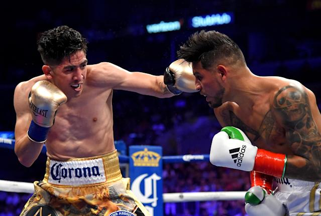 Leo Santa Cruz (L) battles to defeat Abner Mares (R) in their WBA featherweight title and WBC diamond title fight at Staples Center on June 9, 2018 in Los Angeles, California. (Getty Images)