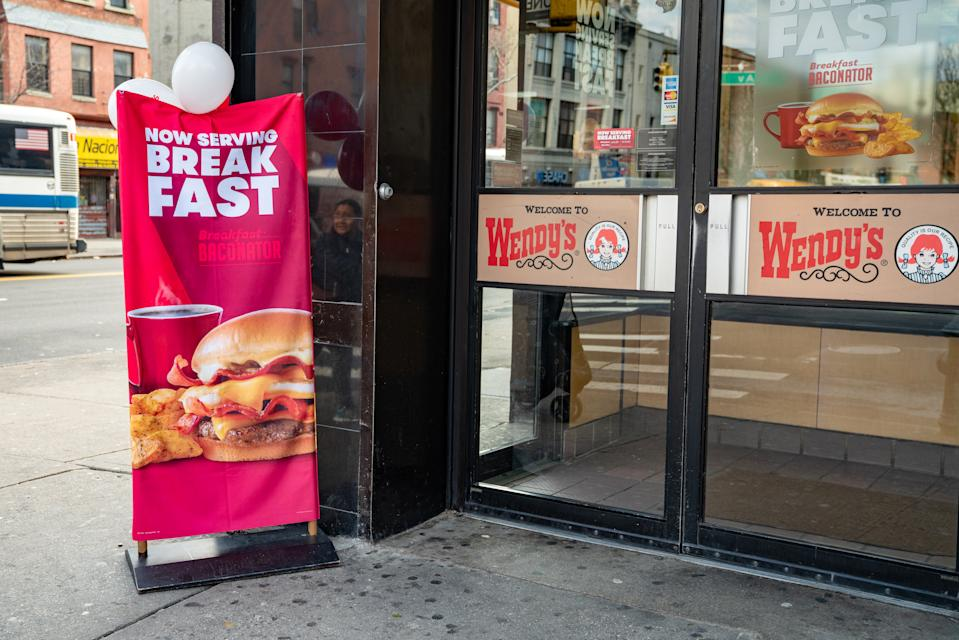 NEW YORK, NY - MARCH 2: A banner announcing Now Serving Breakfast is shown outside a Wendy's restaurant on March 2, 2020 in New York City. Wendy's introduced its breakfast menu nationwide today, featuring items such as the Breakfast Baconator, the Honey Butter Chicken Biscuit and the Frosty-ccino.  (Photo by David Dee Delgado/Getty Images)