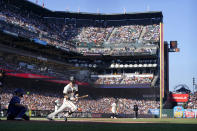 San Francisco Giants' Steven Duggar hits a two-run triple against the Los Angeles Dodgers during the second inning of a baseball game in San Francisco, Sunday, Sept. 5, 2021. (AP Photo/Jeff Chiu)
