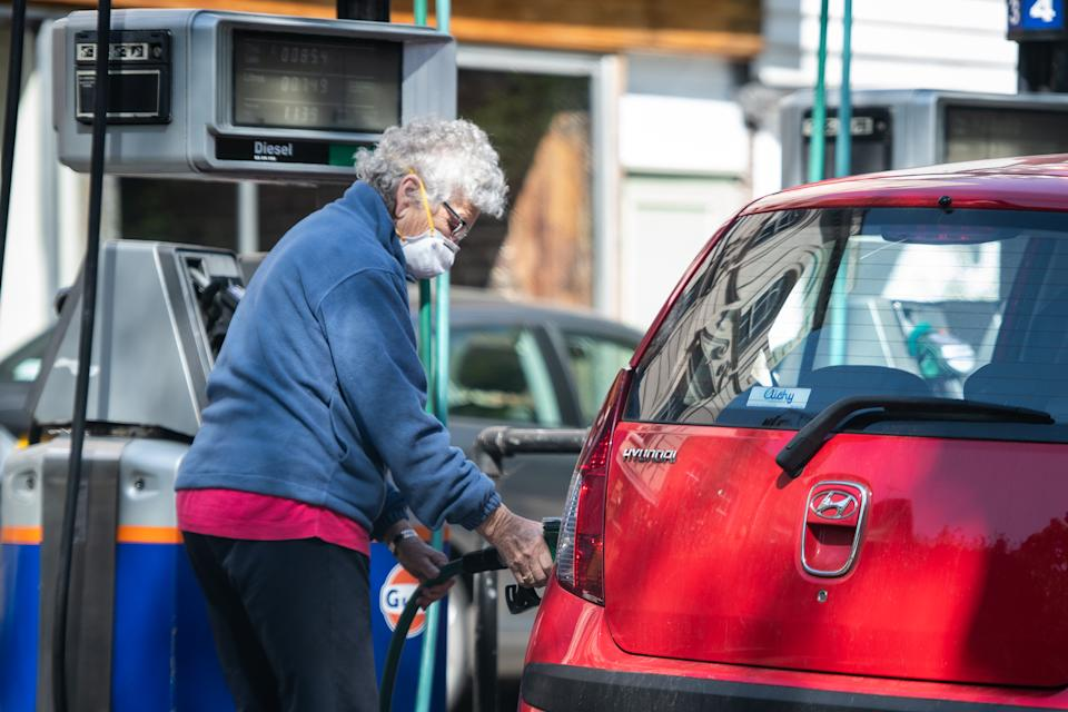 LONDON, UNITED KINGDOM - APRIL 21: A woman fills the petrol tank of her car at an independent petrol station on April 21, 2020 in London, England. The slump in demand for oil due to the ongoing COVID-19 coronavirus pandemic, combined with the failure of oil-producing countries to slow production has resulted in the price of crude oil crashing, with US oil trading briefly at minus $37 a barrel yesterday.  (Photo by Leon Neal/Getty Images)