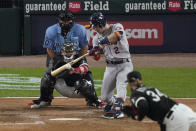 Houston Astros' Alex Bregman (2) hits a one-run single off Chicago White Sox pitcher Michael Kopech (34) in the fourth inning during Game 3 of a baseball American League Division Series Sunday, Oct. 10, 2021, in Chicago. (AP Photo/Charles Rex Arbogast)