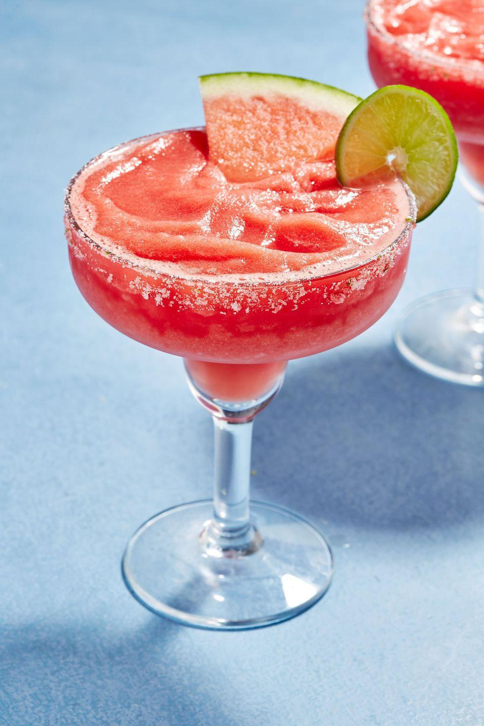 """<p>Pro tip: throw the watermelon in the freezer the night before you make these!</p><p>Get the recipe from <a href=""""https://www.delish.com/cooking/recipe-ideas/a22604091/frozen-watermelon-margaritas-recipe/"""" rel=""""nofollow noopener"""" target=""""_blank"""" data-ylk=""""slk:Delish"""" class=""""link rapid-noclick-resp"""">Delish</a>.</p>"""