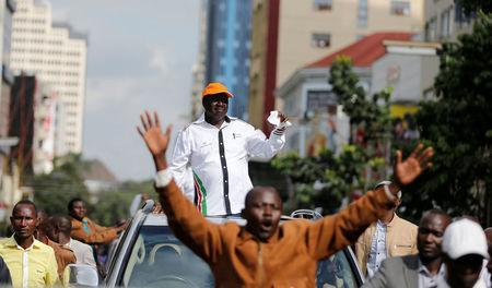 Kenyan opposition leader of the Coalition for Reforms and Democracy (CORD), Raila Odinga waves to his supporters during a protest near the premises hosting the headquarters of Independent Electoral and Boundaries Commission (IEBC) to demand the disbandment of the electoral body ahead of next year's election in Nairobi, Kenya, May 23, 2016. REUTERS/Thomas Mukoya