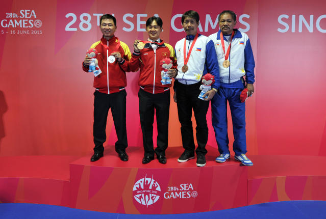 28th SEA Games Singapore 2015 - OCBC Arena Hall - Singapore - 9/6/15 Billiards and Snooker - Mens 1 Cushion Carom - Veitnam's Phi Hung Tran celebrates winning gold with Veitnam's Minh Cam Ma (silver), Philippines' Efren Reyes and Francisco Dela Cruz (bronze) SEAGAMES28 Mandatory Credit: Singapore SEA Games Organising Committee / Action Images via Reuters
