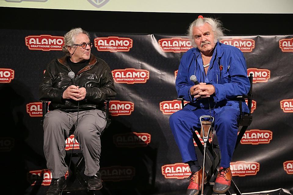 "AUSTIN, TX - MAY 09:  Hugh Keays-Byrne (R) and George Miller speak after the Austin premiere of the new film ""Mad Max Fury Road"" at the Alamo Drafthouse on May 9, 2015 in Austin, Texas.  (Photo by Gary Miller/Getty Images)"