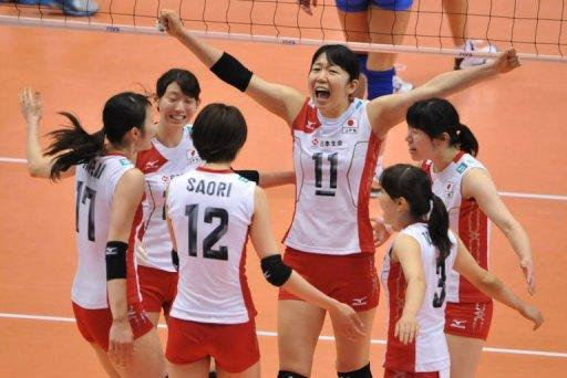 Japan's captain Erika Araki (C) and her teammates react following their point against Serbia