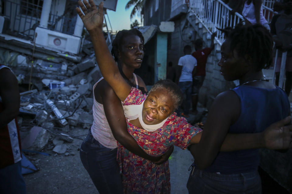 Oxiliene Morency cries out in grief after the body of her 7-year-old-daughter, Esther Daniel, was recovered from the rubble of their home destroyed by the earthquake in Les Cayes, Haiti, Saturday, Aug. 14, 2021. A 7.2 magnitude earthquake struck Haiti on Saturday, with the epicenter about 125 kilometers (78 miles) west of the capital of Port-au-Prince, the U.S. Geological Survey said. (AP Photo/Joseph Odelyn)