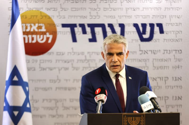 Yesh Atid party leader, Yair Lapid, speaks to the media in the Knesset, Israel's parliament, in Jerusalem
