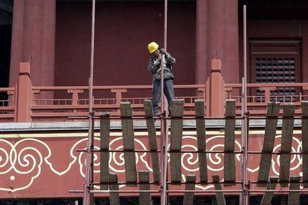 A labourer works at the Drum Tower in Beijing