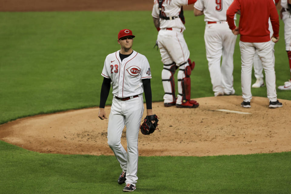 Cincinnati Reds' Jeff Hoffman walks to the dugout after he is removed from the game during the third inning of a baseball game against the Chicago White Sox in Cincinnati, Tuesday, May 4, 2021. (AP Photo/Aaron Doster)
