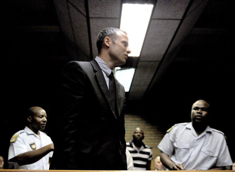 "South Africa's Olympic sprinter Oscar Pistorius leaves the court after his hearing on the charge of murdering his model girlfriend Reeva Steenkamp, on February 15, 2013 at the Magistrate Court in Pretoria. Pistorius broke down in tears in the dock as he was charged with the Valentine's Day murder of his model girlfriend, a charge he denied""in the strongest terms"""