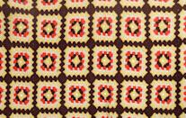 """<p>These throws were crocheted in a repeating """"granny"""" square pattern, using colors that clashed. Often made from scratchy wool, they were better tossed over the back of the couch than used to cover up with during movie night.</p>"""