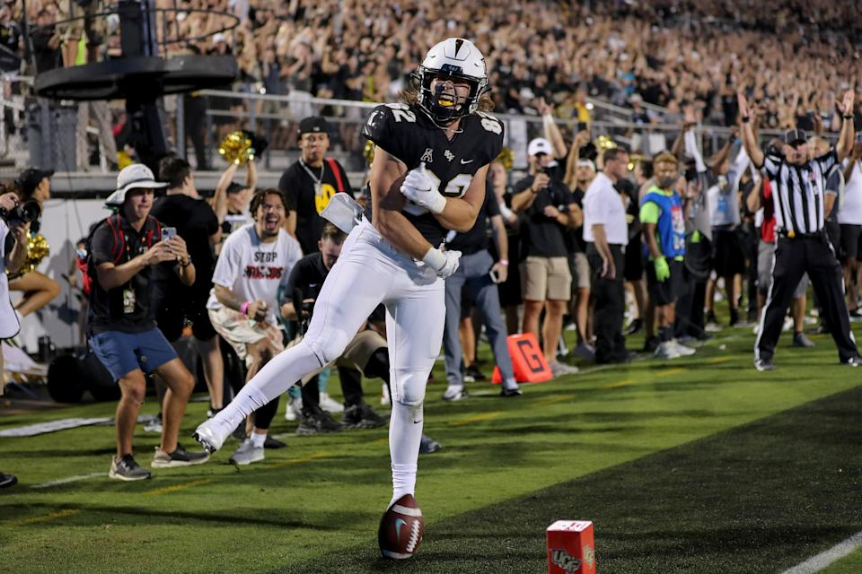 ORLANDO, FL - SEPTEMBER 02:   Alec Holler #82 of the UCF Knights celebrates his touchdown catch against Boise State Broncos at the Bounce House on September 2, 2021 in Orlando, Florida. (Photo by Alex Menendez/Getty Images)