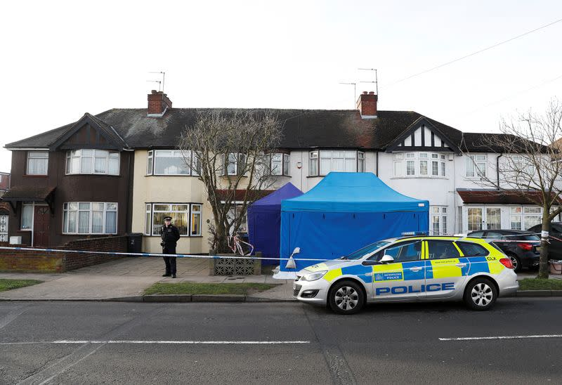 Police stand on duty outside the home of Nikolai Glushkov in New Malden, on the outskirts of London