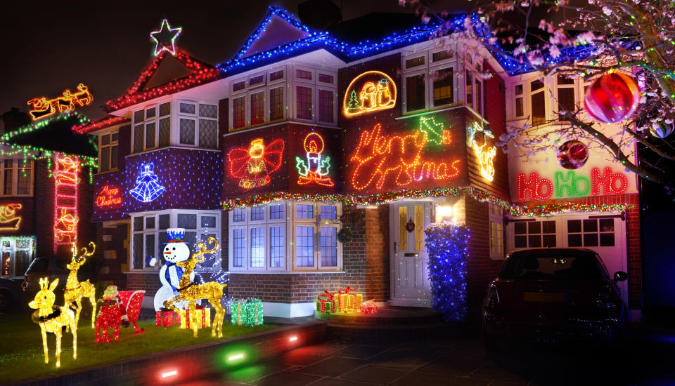 Putting up Christmas lights can even help you bond with your neighbours [Photo: Getty]