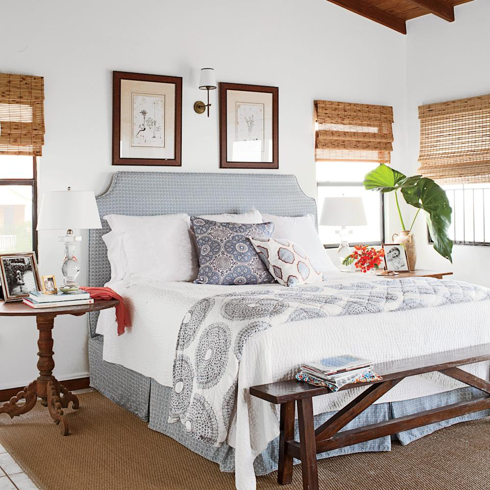 <p>In this Caribbean getaway, homeowner Allison Elebash mixed antiques with classic blue and gray patterns on the headboard, linens, and pillows that hone in on the family's traditional style.</p>