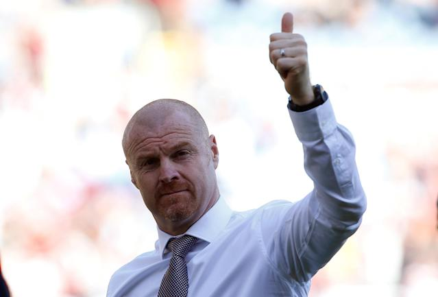 "Soccer Football - Premier League - Burnley vs AFC Bournemouth - Turf Moor, Burnley, Britain - May 13, 2018 Burnley manager Sean Dyche salutes their fans during a lap of honour after the match Action Images via Reuters/Craig Brough EDITORIAL USE ONLY. No use with unauthorized audio, video, data, fixture lists, club/league logos or ""live"" services. Online in-match use limited to 75 images, no video emulation. No use in betting, games or single club/league/player publications. Please contact your account representative for further details."