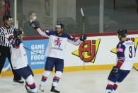 Mike Hammond of Great Britain, centre with teammates celebrate a goal during the Ice Hockey World Championship group A match between the Belarus and Great Britain at the Olympic Sports Center in Riga, Latvia, Wednesday, May 26, 2021. (AP Photo/Roman Koksarov)
