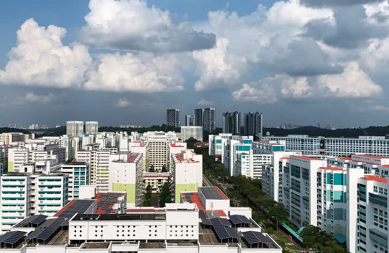 A view of public apartment blocks, with solar panels affixed to the roof of some blocks, in Singapore