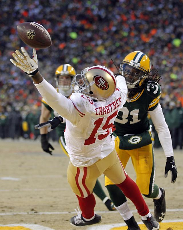 San Francisco 49ers wide receiver Michael Crabtree (15) misses a pass reception against Green Bay Packers cornerback Davon House (31) during the first half of an NFL wild-card playoff football game, Sunday, Jan. 5, 2014, in Green Bay, Wis. (AP Photo/Mike Roemer)