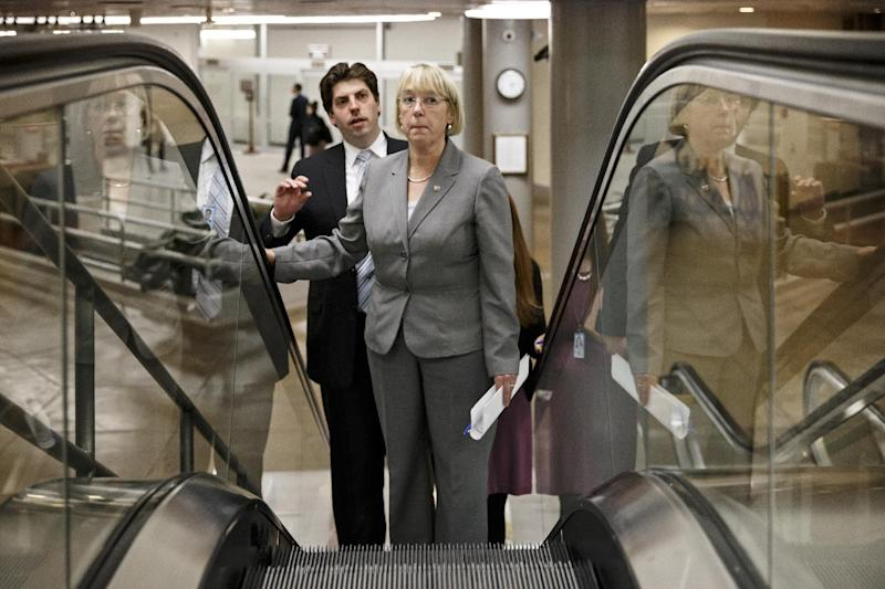 Senate Budget Committee Chairwoman Patty Murray, D-Wash., who negotiated a bipartisan budget compromise with Rep. Paul Ryan, R-Wis., the House Budget Committee chairman, takes an escalator to the Senate for votes on nominations late Monday evening, Dec. 16, 2013, at the Capitol in Washington. Bipartisan legislation to soften across-the-board spending cuts gained ground among Senate Republicans on Monday and Democrats expressed optimism it would gain the 60 votes needed to pass by week's end. (AP Photo/J. Scott Applewhite)