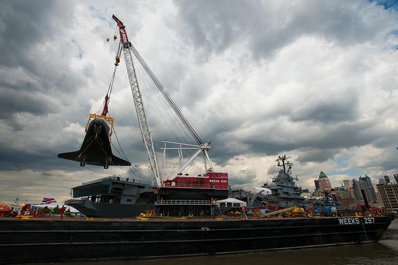 Space shuttle Enterprise is craned onto the flight deck of the Intrepid Sea, Air & Space Museum in New York City on June 6, 2012.