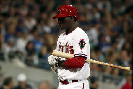 FILE PHOTO: Arizona Diamondbacks player Didi Gregorius walks off the field after being struck out during the opening game against the Los Angeles Dodgers of the 2014 Major League Baseball season at the Sydney Cricket Ground March 22, 2014. REUTERS/David Gray
