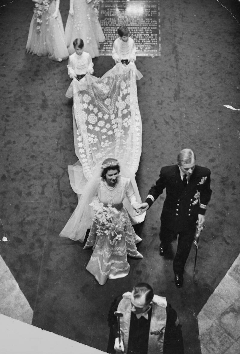 20th November 1947: Queen Elizabeth II (as Princess Elizabeth) with Prince Philip, Duke of Edinburgh, on their wedding day in Westminster Abbey, London. Original Publication: Picture Post - 4438 - Royal Wedding - pub. 1947 (Photo by Bert Hardy/Picture Post/Getty Images)